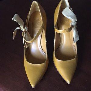 Mustard color Tory Burch high heels